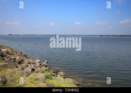 a man made reservoir known as a tank at the polonnaruwa archaeology park in the cultural triangle of sri lanka - Stock Image