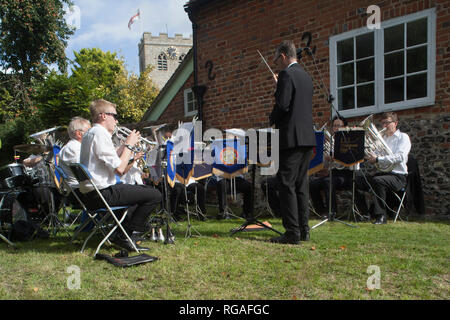 The Cholsey and Blewbury Brass Band play by the Church at Ewelme Harvest Fete, Oxfordshire - Stock Image