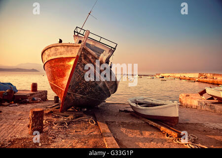 Old wreck in Koroni harbour in Greece - Stock Image