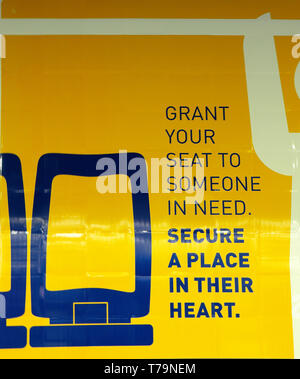 'Grant Your Seat to Someone in Need' SECURE A PLACE IN THEIR HEART poster sign in railway and underground stations in Portugal Europe EU  KATHY DEWITT - Stock Image