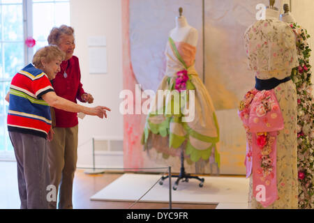 Roslyn, New York, U.S. - April 12, 2014 - During International Slow Art Day, visitors view a Robe de Style dress and an Evening Coat by Callot Soeurs, and an Evening Ensemble by Mainhocker, at the Garden Party exhibit at the Nassau County Museum of Art on Long Island. Credit:  Ann E Parry/Alamy Live News - Stock Image