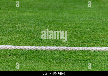 Rope marking the boundary of a rural village cricket pitch - Stock Image