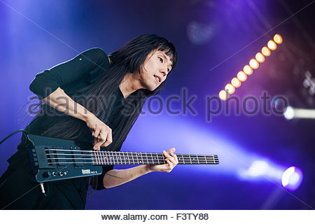 Japanese acid punk band Bo Ningen performing live : Taigen Kawabe (bass/vocals) - Stock Image