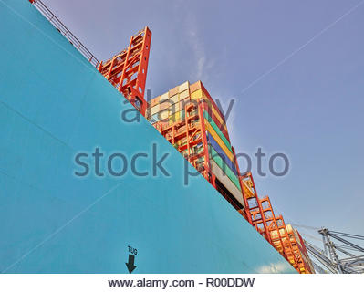 Low angle view of containers on cargo ship - Stock Image