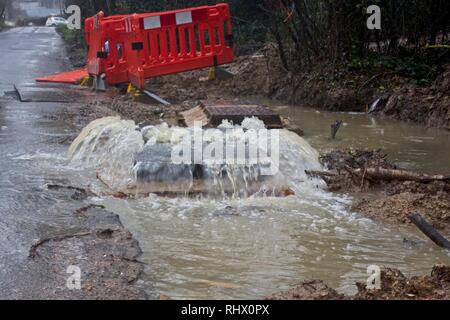 Hailsham, UK. 4th Feb, 2019. UK weather.A manhole struggles to cope after todays heavy rain in Hailsham, East Sussex, UK. Credit: Ed Brown/Alamy Live News - Stock Image