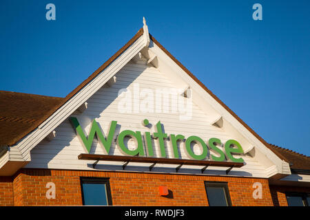 The Waitrose sign on the front of the Waitrose store in Henley-on-Thames, Oxfordshire. - Stock Image