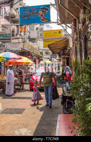 Bangkok, Thailand - 6th March 2017: A man and his daughter walk down the street in little Arabia. The area is just off Sukhumvit Road. - Stock Image