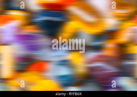 Abstract decorative colorful blurred background. Beautiful optimistic festive texture with rich colors, wavy dynamic motion and 3D sense. Celebrations. - Stock Image