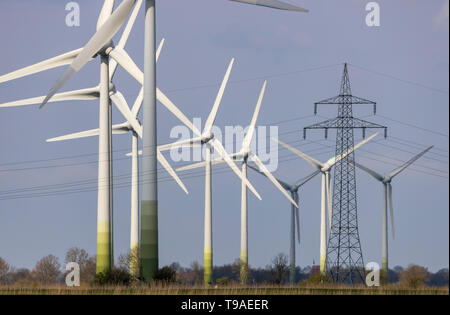 Power lines, wind farm near the city Norden, in East Frisia, Lower Saxony, Germany, - Stock Image