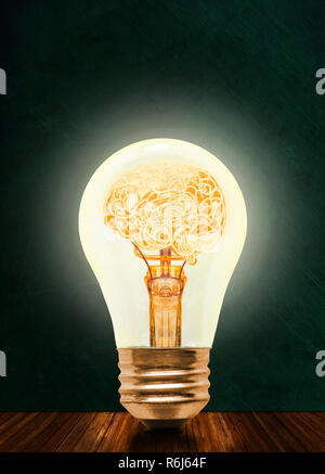 Anatomy of a human brain glowing inside illuminated light bulb with blackboard background and copy space. Concept of bright idea, brainstorming, intel - Stock Image