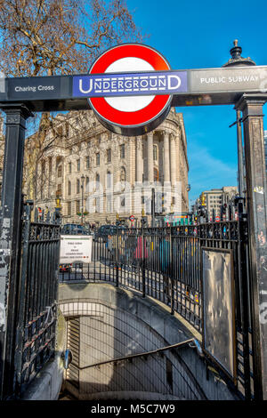 Public subway entrance and steps leading down to Charing Cross Underground tube station, located on Trafalgar Square - Stock Image