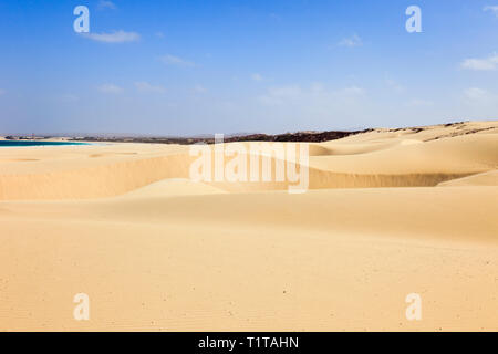 View of large sand dunes on pristine sandy beach. Praia de Chaves, Rabil, Boa Vista, Cape Verde Islands, Africa - Stock Image