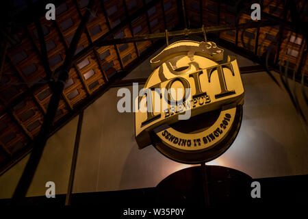 Toits Brewpub's sign outside their venue on a late evening. - Stock Image