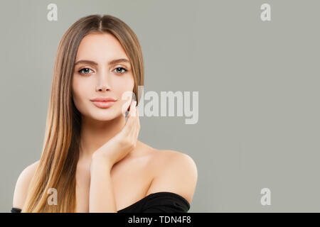 Beautiful girl portrait. Smiling young woman with brown hair - Stock Image