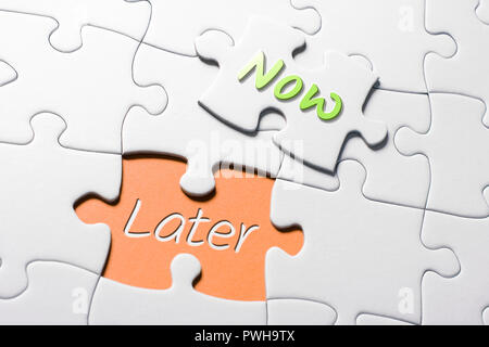 The Words Now And Later In Missing Piece Jigsaw Puzzle - Stock Image