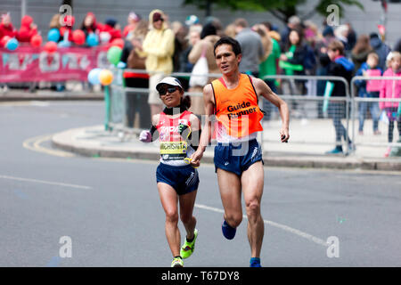 Misato Michishita (JPN), with her Guide runner, competing in the 2019 London Marathon. She went on to win the T11/12 Category in  a time of 03:06:18 - Stock Image