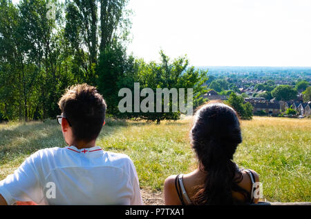 London, England. 7th July 2018. Ekta and Dan enjoying the view over Harrow in the sunshine. The present heatwave is set to continue. ©Tim Ring/Alamy Live News - Stock Image