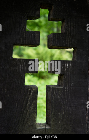 Wooden orthodox cross on abandoned cemetery Jaworzec village Bieszczady mountains Subcarpathian Voivodeship south-eastern Poland - Stock Image