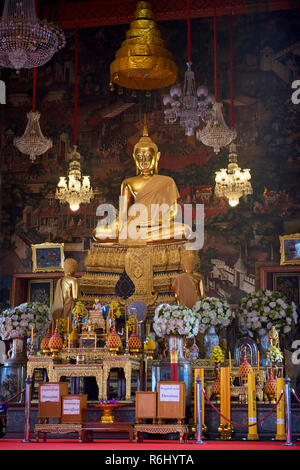 Golden Buddha statue inside one of the Ordination Hall's Buddhist temples in Bangkok, Thailand. - Stock Image