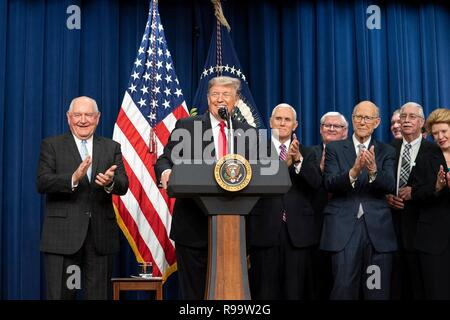 U.S. President Donald Trump smiles during the signing ceremony for H.R. 2, the Agriculture Improvement Act of 2018, in the South Court Auditorium of the Eisenhower Executive Office Building December 20, 2018 in Washington, DC. - Stock Image