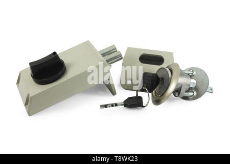 Mechanism of the door lock with the keys in the disassembled form Isolated on white - Stock Image