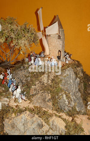 Creche figures and scenes made in Provence.  Here a Provencal Windmill scene on a hill with santons. La Garde-Freinet (Var, France) - Stock Image