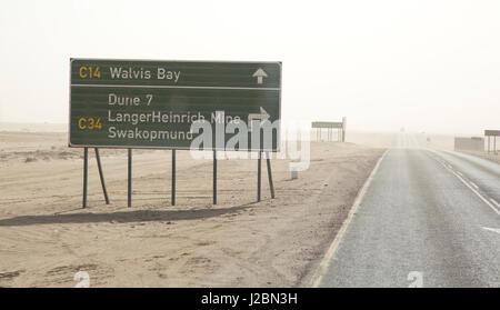 Africa, Namibia, Namib Desert, Walvis Bay. Road sign and sandstorm. Credit as: Wendy Kaveney / Jaynes Gallery / - Stock Image