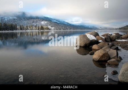 Patchy fog hovers over Donner Lake, CA, during an early January morning. - Stock Image