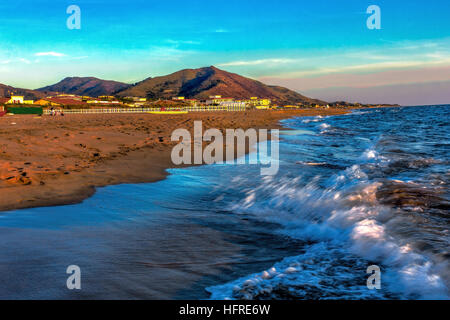 Sunset above sea of Baia Domizia, Italy - Stock Image