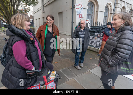 London, UK. 19th Dec, 2018. North West Durham Labour MP Laura Pidcock talks with DPAC's Paula Peters and others at the protest in support of the parliamentary debate due later in the day on the cumulative impact of the cuts on the lives of disabled people. They say the government cuts and changes in benefits, along with inappropriate benefit sanctions, have had a disproportionate effect on disabled people, resulting in great hardship, denying people their rights and many deaths. Credit: Peter Marshall/Alamy Live News - Stock Image