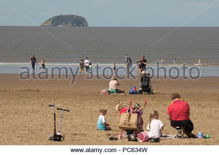 Weston-super-Mare, Somerset. 31st July 2018. UK Weather: The warm weather returns with temperatures set to rise through the week. these families take advantage of the warm sun and high tide on the beach at Weston-s-Mare, Somerset U.K. Credit: Stephen Hyde/Alamy Live News - Stock Image