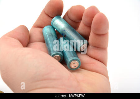 Three AAA batteries isolated on white background - Stock Image