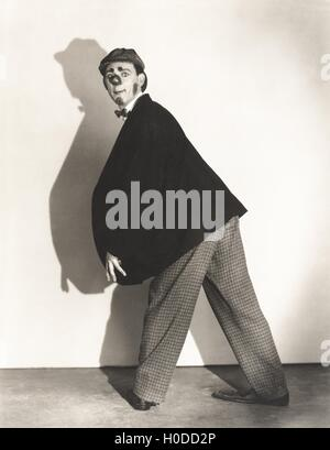 Man wearing rubber clown nose - Stock Image