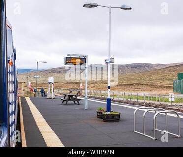 Corrour rural train station platform with ScotRail train on West Highland railway line, Scottish Highlands, Scotland, UK - Stock Image