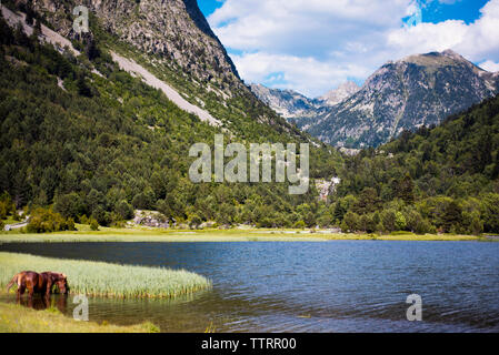 Scenic view of lake against mountains in Valley of Boi - Stock Image