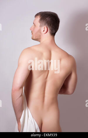 Portrait of a naked man, studio shot - Stock Image