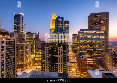 Minneapolis, Minnesota skyline at dusk as seen from the 30th floor of the 365 Nicollet apartment tower. - Stock Image