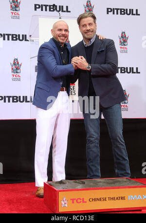 Pitbull is honoured with a hand and footprint ceremony at the TCL Chinese Theatre  Featuring: Pitbull, John Travolta Where: Hollywood, California, United States When: 14 Dec 2018 Credit: FayesVision/WENN.com - Stock Image