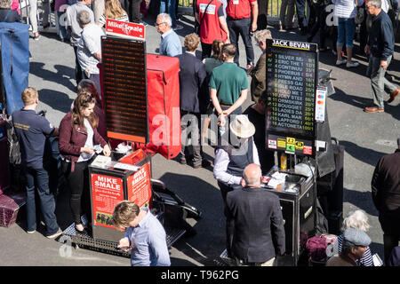 Track side bookmakers at Newton Abbot racecourse, Devon, UK. Bookies at the races, horse racoing course. - Stock Image