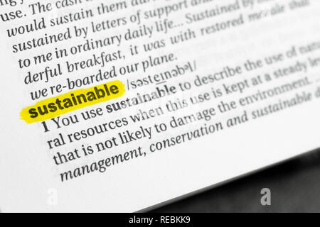 Highlighted English word 'sustainable' and its definition at the dictionary. - Stock Image