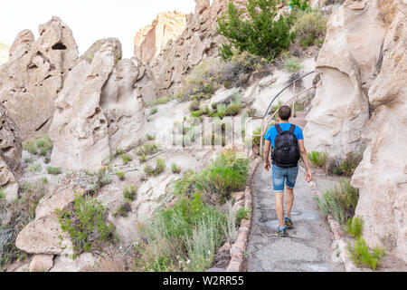 Park with man hiker walking on Main Loop trail path in Bandelier National Monument in New Mexico - Stock Image
