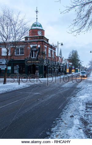 Fleet, Hampshire, UK. 2nd Feb, 2019. Heavy overnight snow followed by a sharp frost made for a difficult early morning for pedestrians and motorists. Image: Early morning traffic was light and moving carefully. Credit: Images by Russell/Alamy Live News - Stock Image