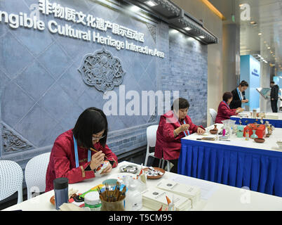 (190423) -- BEIJING, April 23, 2019 (Xinhua) -- Inheritors of intangible cultural heritage demonstrate handicraft art at the Intangible Cultural Heritage Interactive Area of the Media Center for the second Belt and Road Forum for International Cooperation in Beijing, capital of China, on April 23, 2019. The media center started trial operation at the China National Convention Center in Beijing Tuesday. More than 4,100 journalists, including 1,600 from overseas, have registered to cover the second Belt and Road Forum for International Cooperation to be held from April 25 to 27 in Beijing. (Xinh - Stock Image