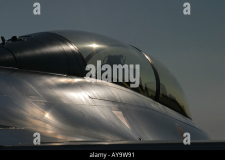 Glistering metal on F16 Fighting falcon dual seat trainer fighter aircraft - Stock Image