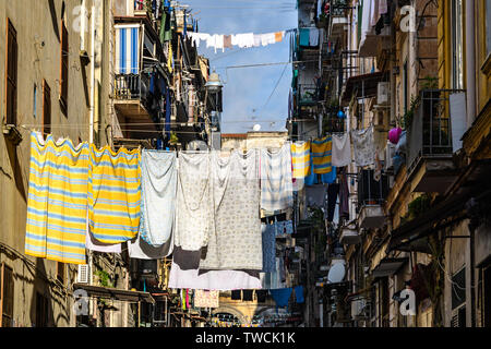 Typical street scene with laundry in the Old Town of Naples, Italy - Stock Image