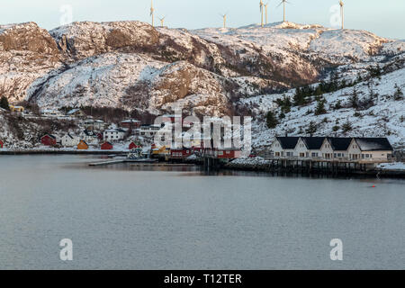One of the many small isolated village settlements on the coast of the Norwegian Fjords, during winter. - Stock Image