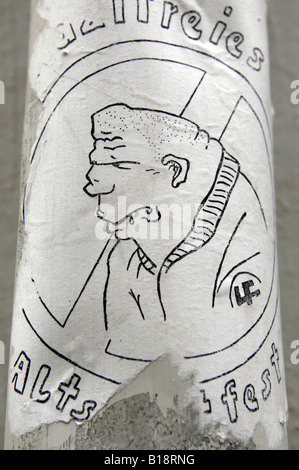 anti nazi graffiti sticker thug meathead idiot imbecile anti fascist german sticker on lampost goslar harz mountains - Stock Image