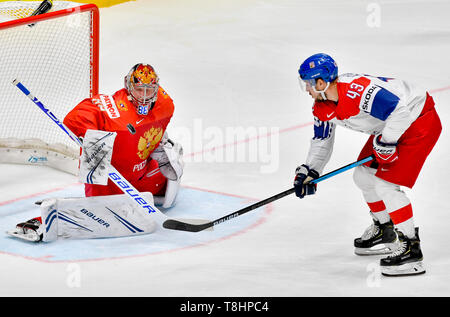 Bratislava, Slovakia. 13th May, 2019. From right Czech ice hockey player JAN KOVAR and goalie of Russia ANDREI VASILEVSKIY in action during the match Czech Republic against Russia at the 2019 IIHF World Championship in Bratislava, Slovakia, on May 13, 2019. Credit: Vit Simanek/CTK Photo/Alamy Live News - Stock Image
