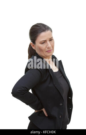 Middle aged woman with chronic pain syndrome fibromyalgia suffering from acute back ache, isolated on white background - Stock Image