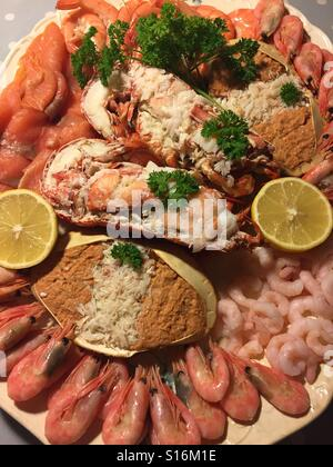 Luxury seafood platter. Dressed crab and lobster with smoked salmon and prawns of various types - Stock Image
